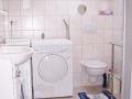 Bad mit Waschmaschine, Trockner